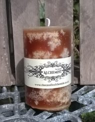 Pillar Candle in speckled amber tones fragranced with Cinnamon & Orange